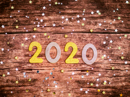 The number 2020 surrounded by sparkling lights to bring in the new year!